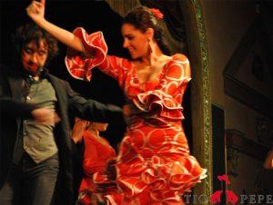 two-flamenco-dancers-and-tio-pepe-logo