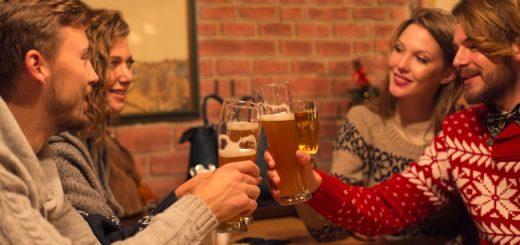 Friends having beers in restaurant.