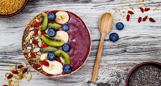 Acai bowl breakfast superfoods smoothies bowl with chia seeds, bee pollen